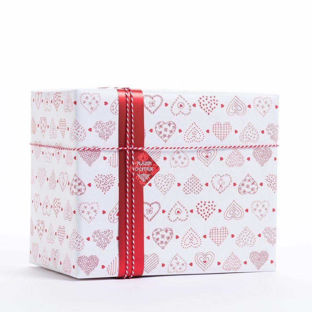 Papier cadeau coeurs aux motifs variés en 0.70x100 m (photo)