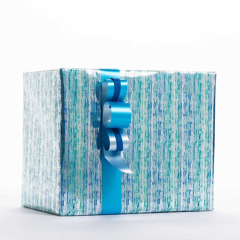 Papier cadeau lignes vert et bleu 0,70 x 50 m (photo)
