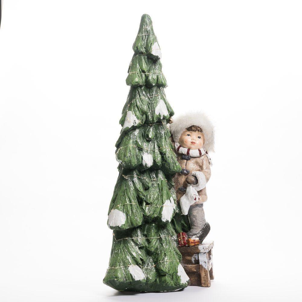 Sapin lumineux en céramique avec enfant L 43 x P 28 x H 85 cm (photo)