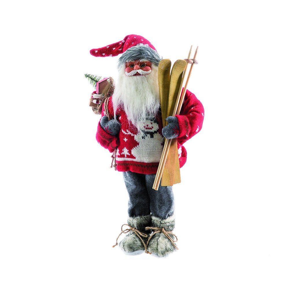 Père Noël pull rouge bonhomme de neige tenant skis H. 60cm (photo)