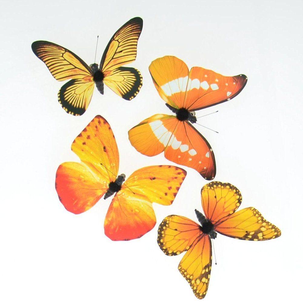 Papillons oranges coloris et dimensions assortis - sachet de 4 (photo)