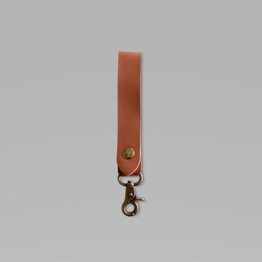 Lanière en cuire brun avec pression et mousqueton, par 50