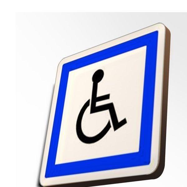 Couvre-chant : stationnement réservé aux personnes handicapées (photo)